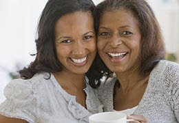 Smiling African American mother and daughter